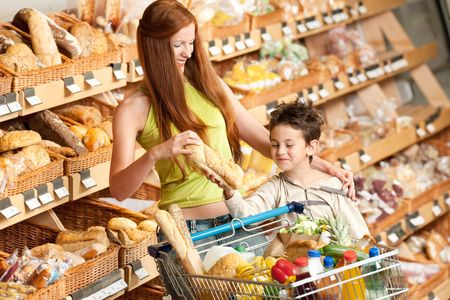 Woman and child buying bread in a supermarket photo