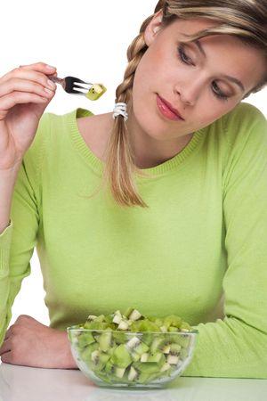 Woman eating kiwi  on white background photo