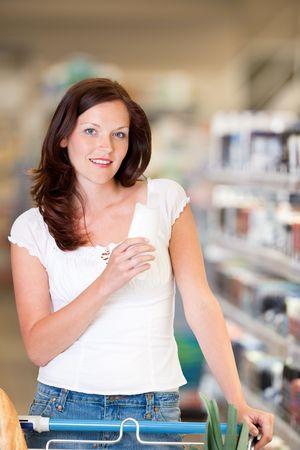 Brown hair woman buying shampoo photo