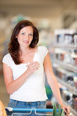 woman shopping cart: Brown hair woman buying shampoo Stock Photo