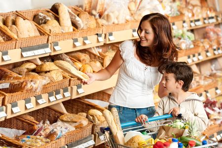 Brown hair woman with child buying bread photo