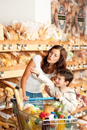 Mother with child in a supermarket photo