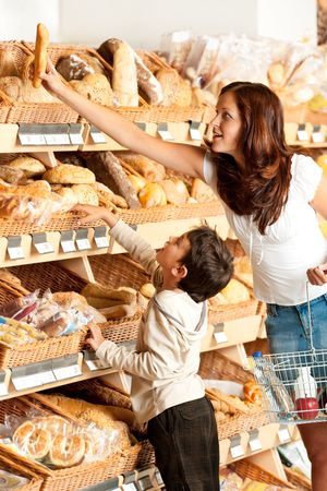 Young woman with child choosing bread photo