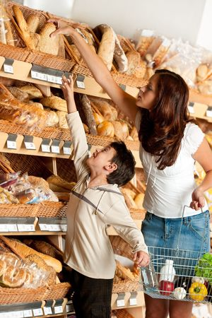 Woman with child choosing bread photo
