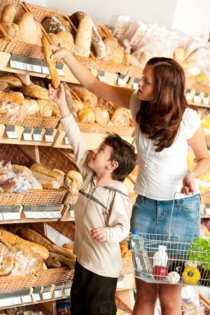 Woman with little boy buying bread photo