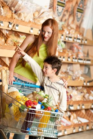 Red hair woman and child in a supermarket photo