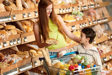 Red hair woman with child shopping photo