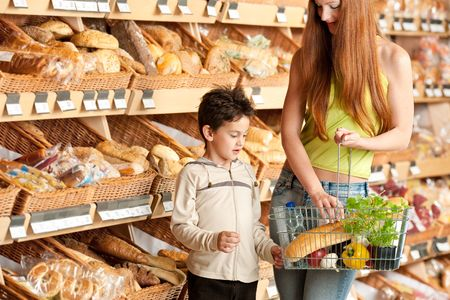 Red hair woman with child in a supermarket photo