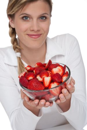 Healthy lifestyle series - Woman and bowl of strawberries on white background Stock Photo - 5011618