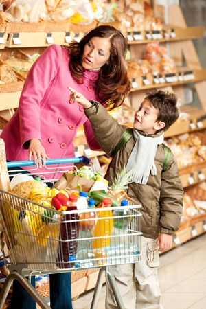 supermarket series: Shopping series - Woman with child in a supermarket Stock Photo