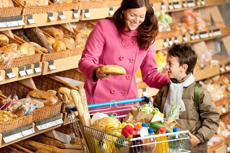 grocery store series: Shopping series - Brown hair woman with child in a grocery store