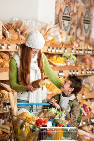 Shopping series - Red hair woman with little boy in a supermarket photo