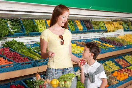 grocery store series: Shopping series - Red hair woman with child in grocery store
