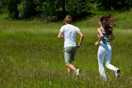 Man and woman jogging outdoors, shallow DOF Stock Photo - 5128597