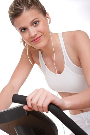 Fitness series - Woman with headphones exercising on white background photo