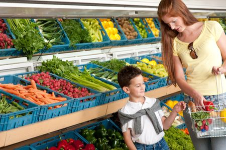 Shopping series - Red hair woman with child in grocery store photo