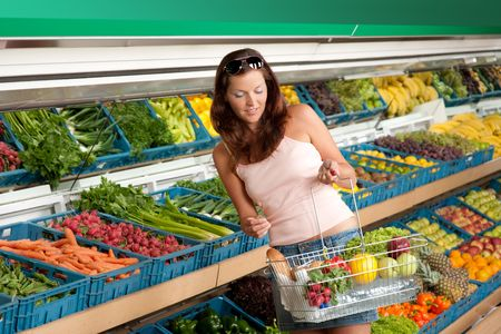supermarket series: Shopping series - Woman in summer outfit in a supermarket Stock Photo
