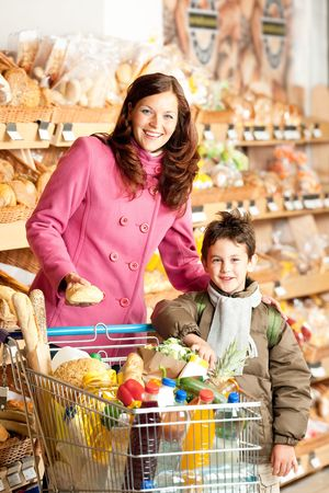 Shopping series - Happy woman and child in a supermarket photo