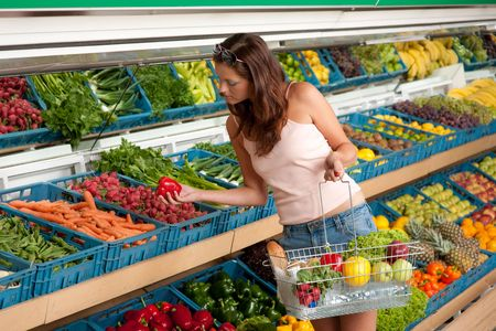 grocery store series: Shopping series - Young woman buying vegetable in grocery store