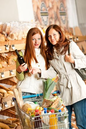 Grocery store: Two young women in a supermarket photo
