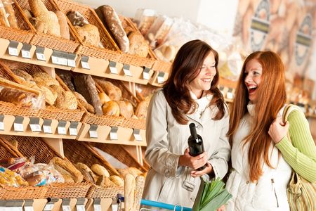 bakery store: Grocery store: Two young women having fun