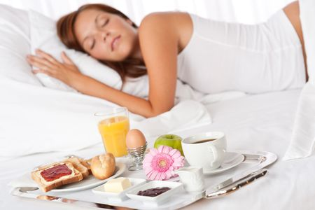 breakfast hotel: Young woman having breakfast in luxury hotel room Stock Photo