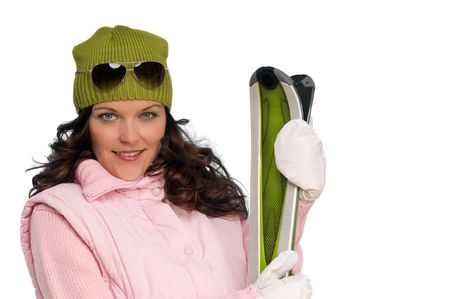 Brown hair woman in winter outfit with skis on white background Stock Photo - 5428004