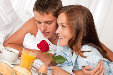 Happy man and woman having luxury hotel breakfast in bed together Stock Photo - 5435137