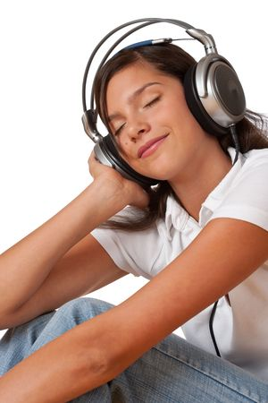 Teenager with closed eyes listening to music with headphones Stock Photo - 5579425