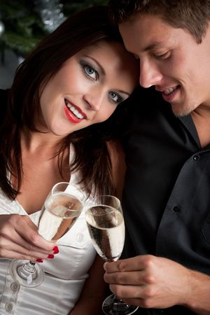 haute couture: Portrait of extravagant man and woman with glass of champagne Stock Photo