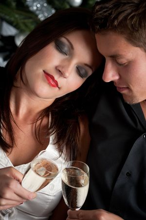 Portrait of extravagant man and woman with glass of champagne photo