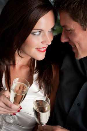 provocative couple: Portrait of extravagant man and woman with glass of champagne Stock Photo