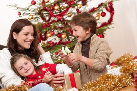Happy family: mother with son and daughter on Christmas Stock Photo - 5714608