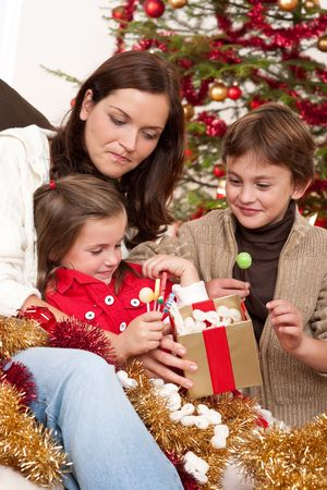 Happy family: mother with son and daughter on Christmas Stock Photo - 5714610