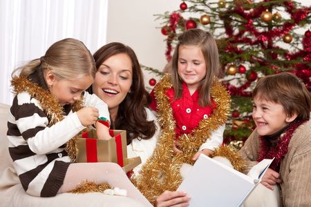 Happy family: mother with three children on Christmas photo