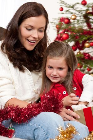 Mother with child opening present on Christmas Stock Photo - 5714603