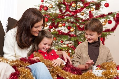 Happy family: mother with son and daughter on Christmas Stock Photo - 5714604