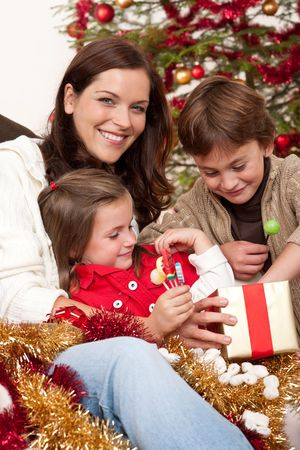 Happy family: mother with son and daughter on Christmas Stock Photo - 5714619