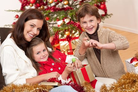 Happy family: mother with son and daughter on Christmas Stock Photo - 5714611