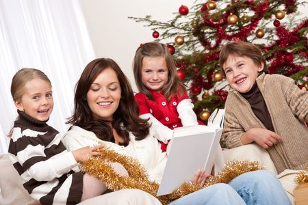 Happy family: mother with three children on Christmas Stock Photo - 5714616