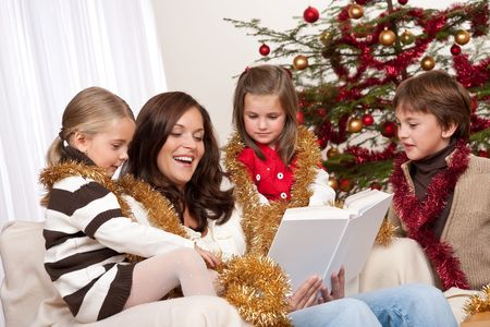 Happy family: mother with three children on Christmas Stock Photo - 5714606
