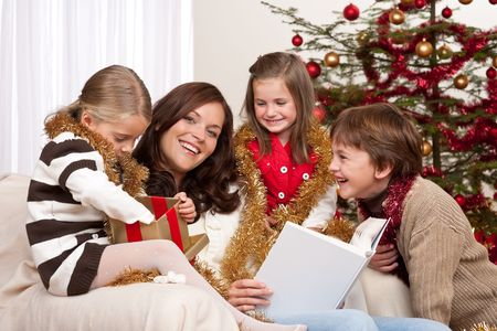 Happy family: mother with three children on Christmas Stock Photo - 5714615