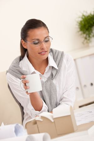 female architect: Female architect at the office having coffee break