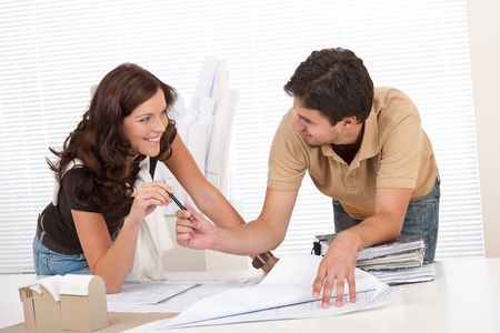 female architect: Man and woman at architect office working together