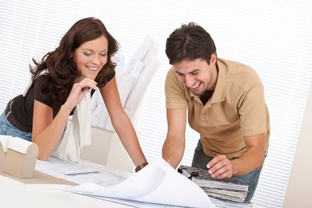 Man and woman at architect office working together photo