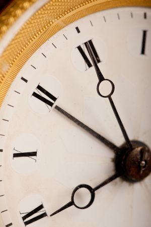 Close-up of antique white and gold clock with Roman numeral, macro lens Stock Photo - 5837671