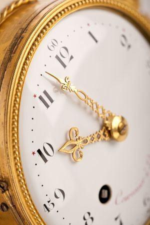 arabic numeral: Close-up of antique gold clock with Arabic numeral, macro lens