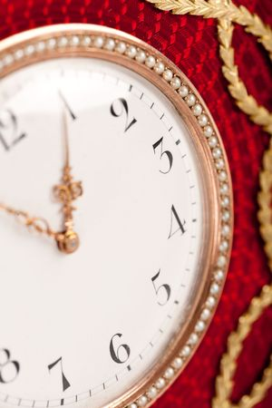 arabic numeral: Close-up of red and gold antique tambour clock with Arabic numeral, macro lens