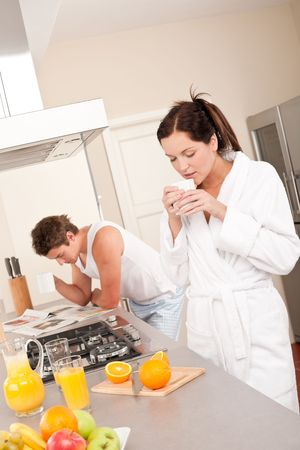 Happy couple having breakfast in the kitchen, drinking coffee Stock Photo - 5854276