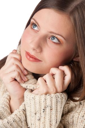 Portrait of beautiful young woman wearing turtleneck on white background photo